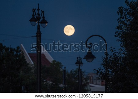 Street lights and full moon in Omsk, Russia