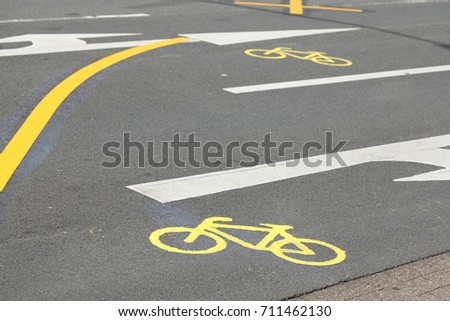 Street mark Arrow, yellow Bike Path #711462130