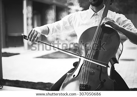 street musician playing on contrabass. black and white vintage