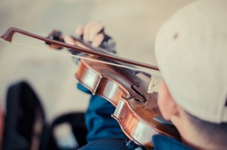 Street musician playing violin,Selective focus and tone color.