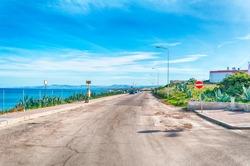 Street near the beach of platamona in a sunny morning - Sardinia