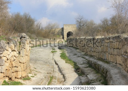 Street of ancient cave thown of Chufut-Kale in early spring, Crimea.