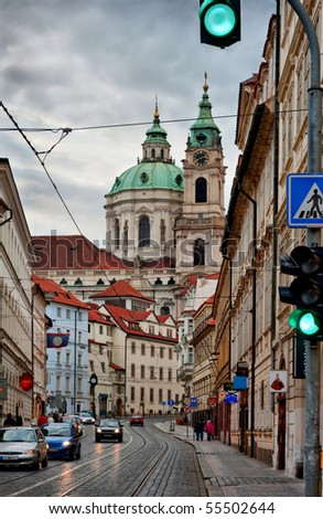 Street of Prague with baroque Saint Nicolas church