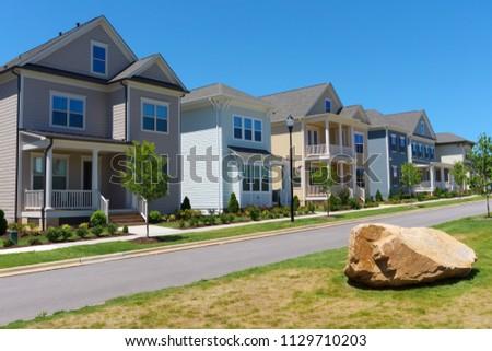 Street of suburban homes #1129710203