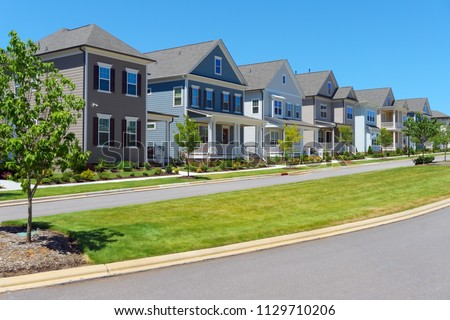 Street of suburban homes #1129710206