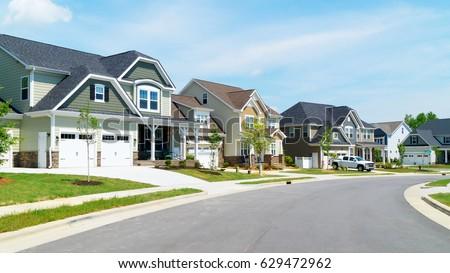 Street of suburban homes #629472962