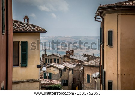 Street of the ancient town of Montalcino in Tuscany. Tuscany, Italy  #1381762355