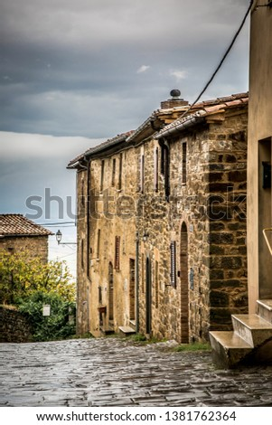 Street of the ancient town of Montalcino in Tuscany. Tuscany, Italy  #1381762364