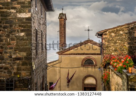 Street of the ancient town of Montalcino in Tuscany. Tuscany, Italy  #1383127448