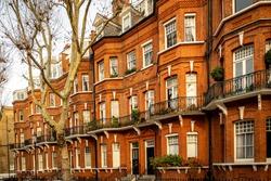 Street of upmarket London red brick townhouses