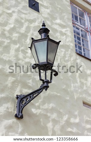 Street old lamp on the wall background