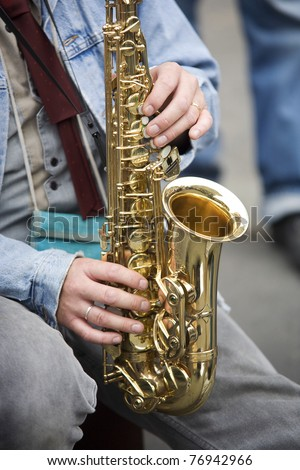 Street performer is playing a sax in Bern, Switzerland.