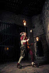 Street Performer Jester with Torch