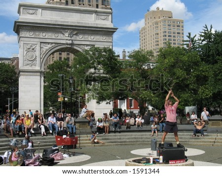 Street performer swallowing sword in Washington Square, New York City