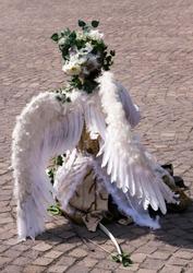 Street performer wearing an angel costume