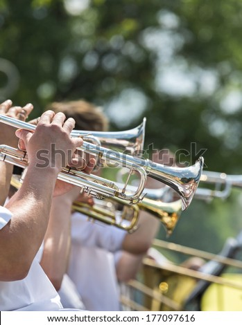 Street performers playing popular music on the trumpet