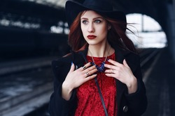 Street portrait of a young beautiful fashionable woman wearing stylish clothes. Model looking aside. Female fashion concept. Closeup
