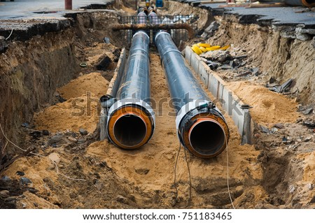 Street reconstruction site of district heating system pipeline and replacement of old pipes with new ones