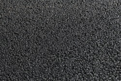 Street resurfacing - fresh asphalt road construction blacktop.