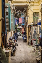 Street scene from a narrow alley in the old quarter in Hanoi. Streets and guilds of the old quarter are a major tourist attraction