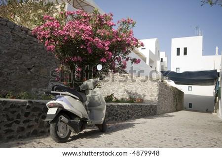 street scene greek islands motor bike scooter with stone road