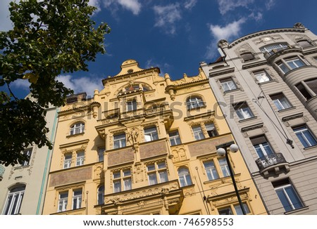 Street scene of multi storey buildings in gold and grey in Prague, Czechoslovakia. #746598553
