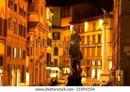 Street scene with a statue, at night, Florence, Italy.