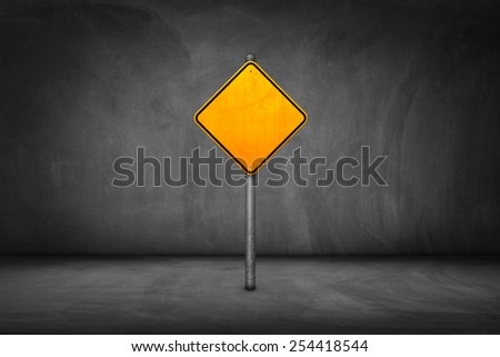 Street Sign: blank yellow road sign with street wall.