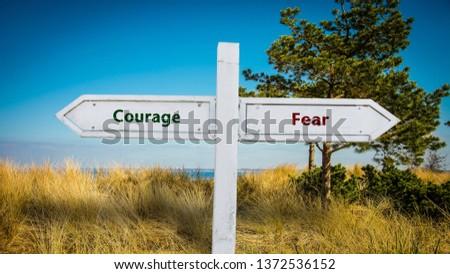 Street Sign Courage versus Fear #1372536152