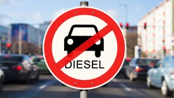 Street Sign diesel driving ban, cars on the street in the background