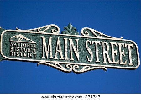 street sign for Main Street with national historic district designation