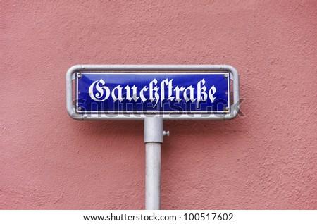 Street sign Gauckstrasse street - A street sign Gauckstrasse street, named like the 11th Federal President of Germany, Joachim Gauck, seen in Freiburg, Black Forest, Germany.