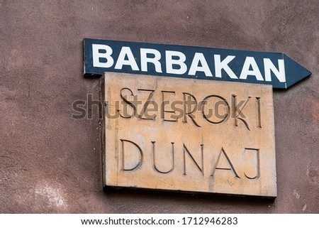 Street sign in Warsaw, Poland for Barbican or Barbakan old town historic fort fortress with Szeroki Dunaj road name Zdjęcia stock ©
