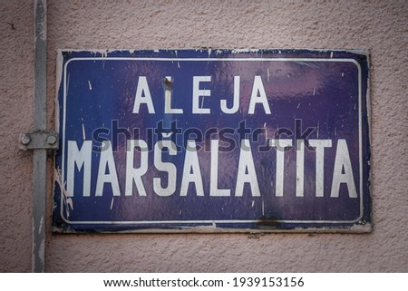 Street sign of Aleja Marsala Tita, meaning Marshall Tito alley in Serbian language. It is the main street of Subotica, Serbia, dedicated to the former communist leader of Yugoslavia, Josip Broz Tito.  Stock fotó ©