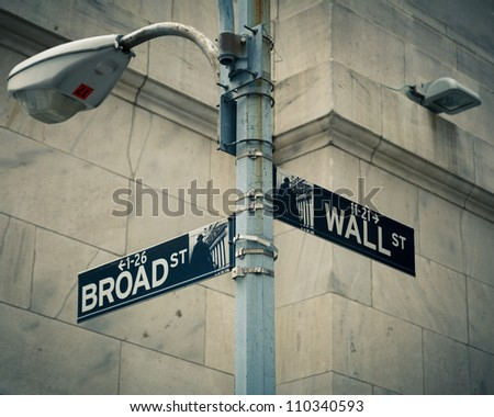Street sign of New York Wall street and Broad street - stock photo