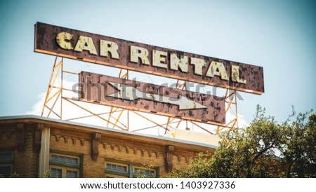 Street Sign the Direction Way to Car Rental #1403927336