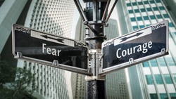 Street Sign the Direction Way to Courage versus Fear
