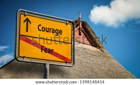 Street Sign the Direction Way to Courage versus Fear #1398148454