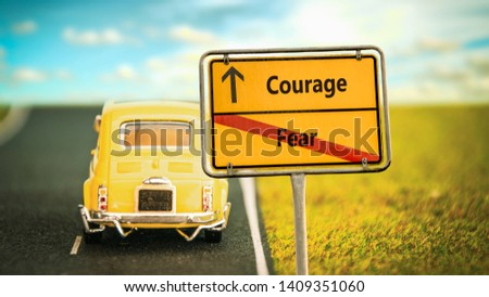 Street Sign the Direction Way to Courage versus Fear #1409351060