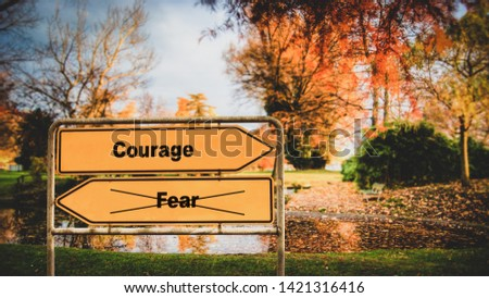Street Sign the Direction Way to Courage versus Fear #1421316416