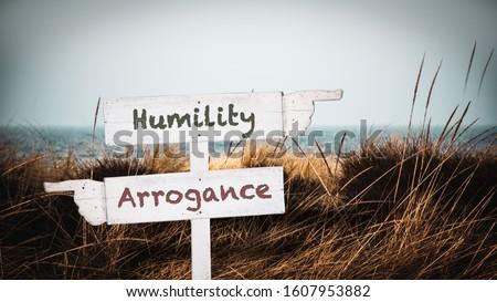 Street Sign the Direction Way to Humility versus Arrogance Stock fotó ©