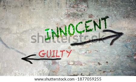 Street Sign the Direction Way to Innocent versus Guilty Stock photo ©