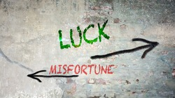 Street Sign the Direction Way to Luck versus Misfortune