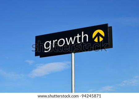 "Street sign with upward arrow reading ""growth"""