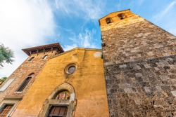 Street square with low angle view of Cattedrale di San Secondiano church in small town village of Chiusi, Italy in Tuscany entrance exterior