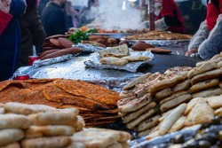 street stalls where local Turkish food is sold. stuffed meat, baklava, olive oil wrap, pastries, lahmacun, stuffed meatballs and meat dishes