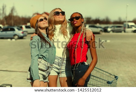 Street style girls. Fashion girls. Hipster. City background. Summer time. Cool.
