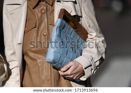 street style outfit - woman wearing cream coat and blue handbag - StreetStyleFW2020 Stock photo ©