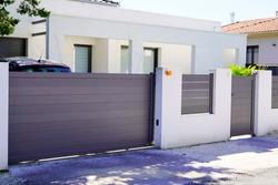 street suburb home grey brown dark metal aluminum house gate slats garden access door
