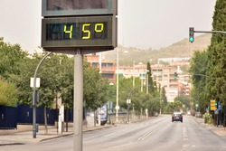 Street thermometer marking 45 degrees celsius in summer, excessive heat